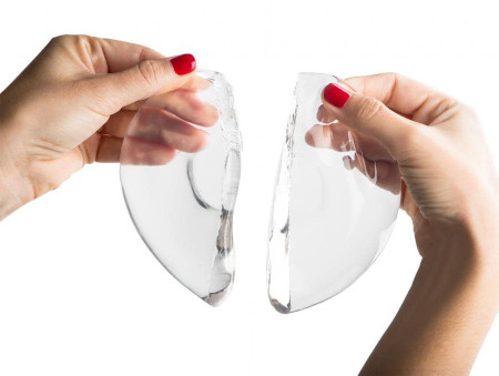 How does the body respond to breast implants?